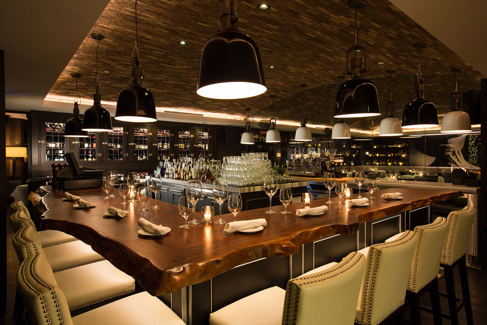 an Interior design photograph of a restaurant bar at night by restaurant Photographer Dallas
