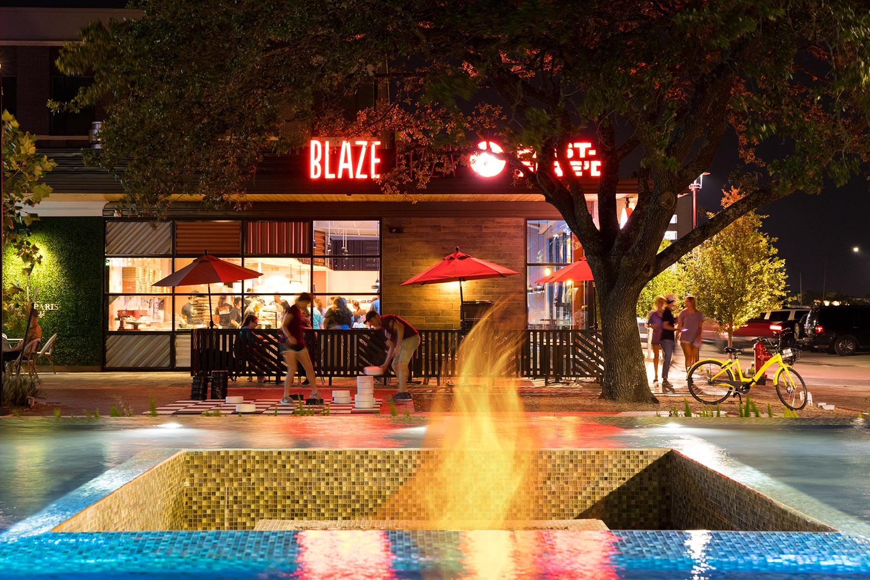 a gas flame and fountain at Century Square in College Station