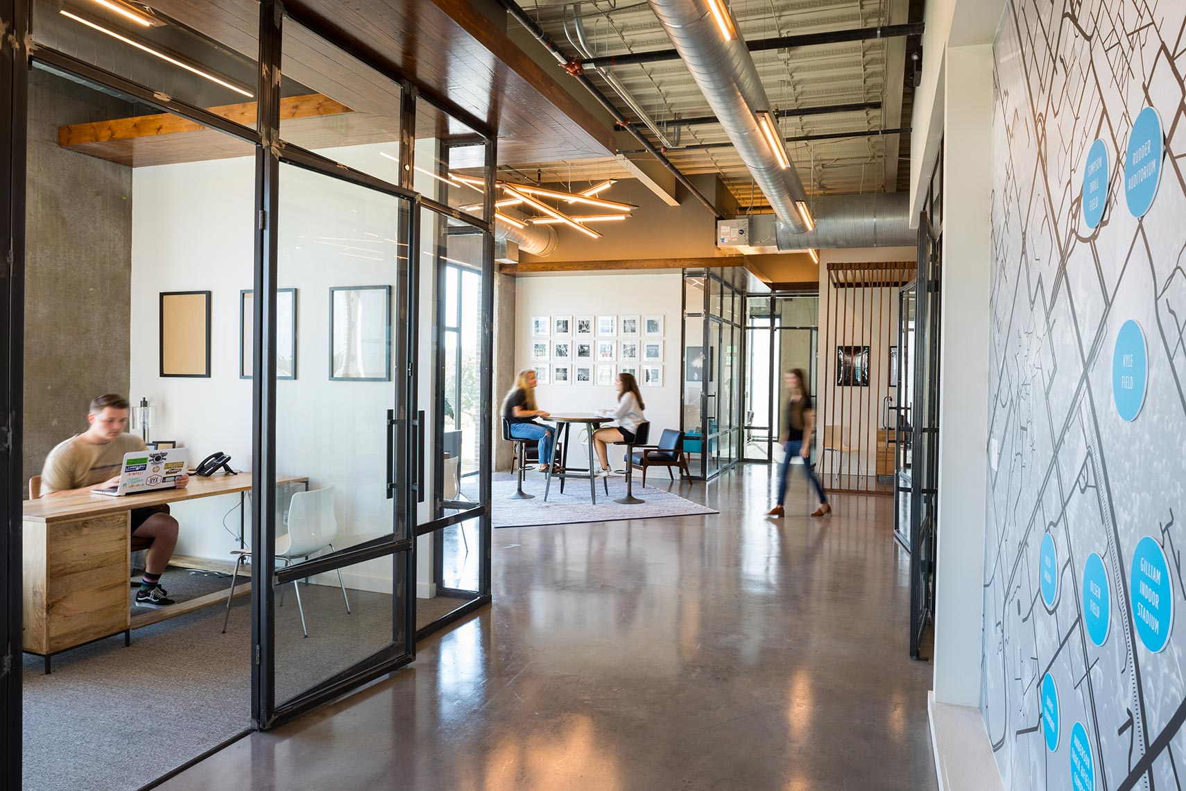 A modern office space showing millennial employees at work by a corporate photographer in Austin Texas