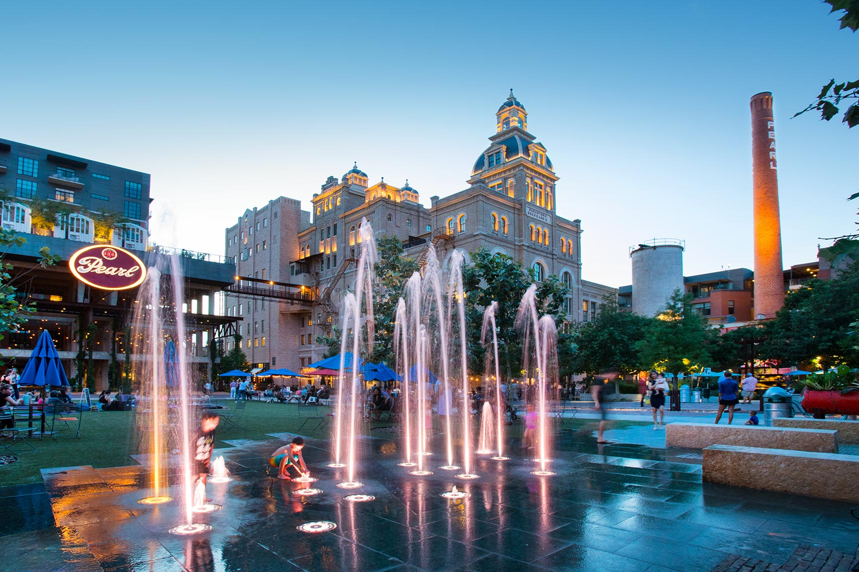 Kids playing in the fountains st the Pearl in San Antonio by Texas Travel Photographer Shannon O