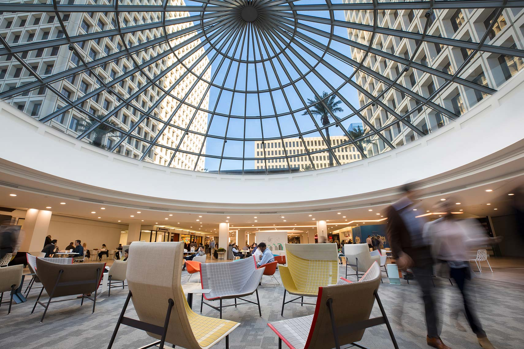 a view of office buildings through large circular skylight at Greenway Plaza in Houston by Architectural photographer