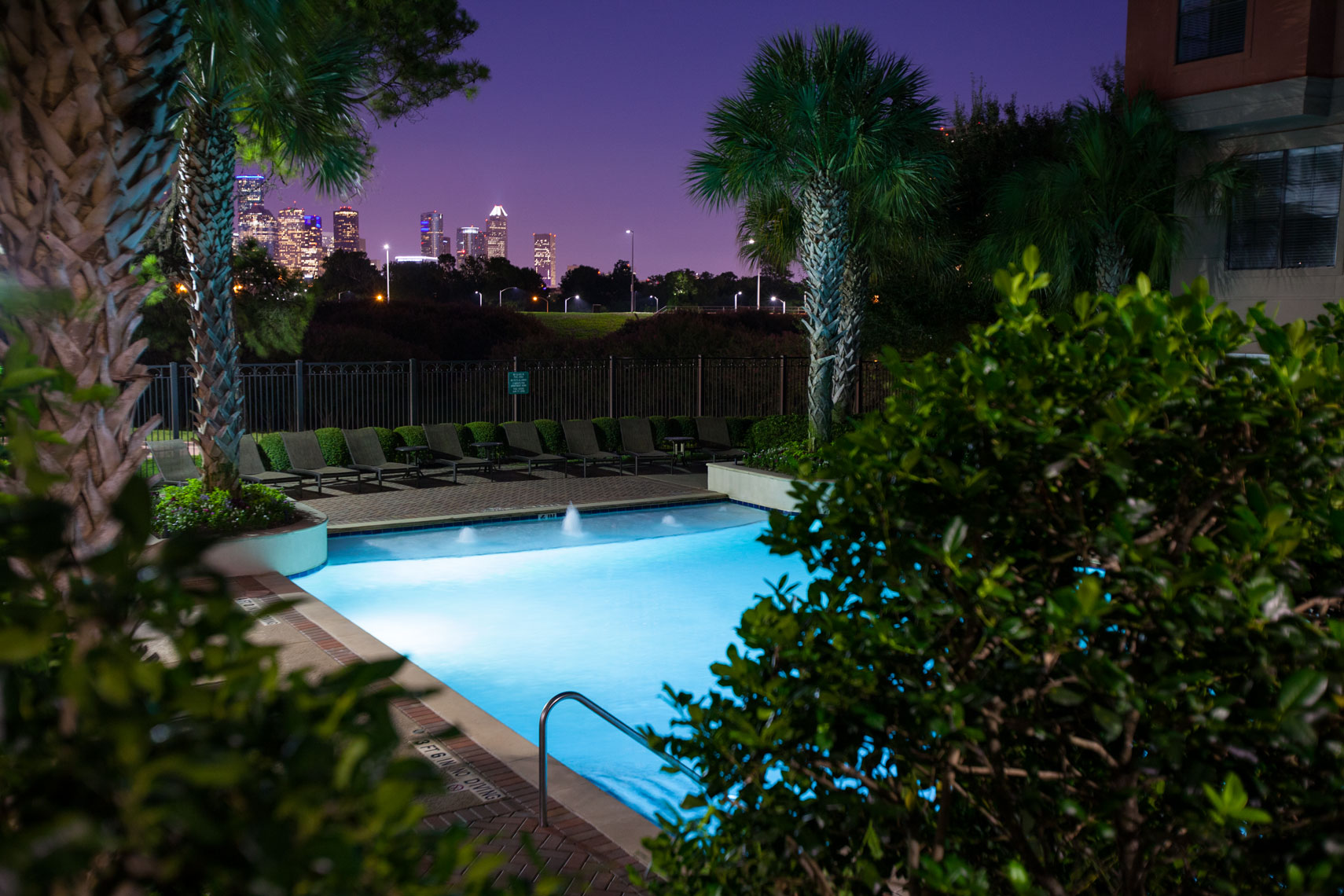 Swimming Pool with a purple sky at a Fingers Property in Houston Texas