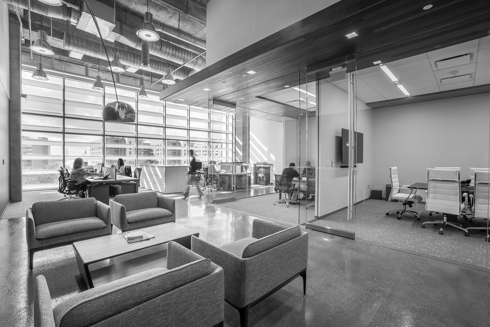 a black and whit photo of a modern office space by an Annual report photographer in Houston, Texas