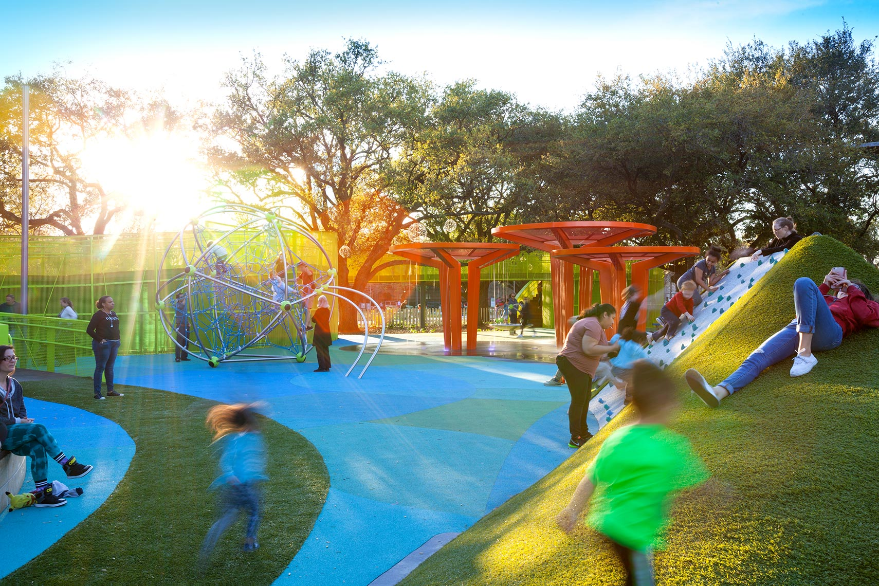 Kids playing at Levy Park in Upper Kirby by Landscape Architectural Photographer in the Gulf Coast